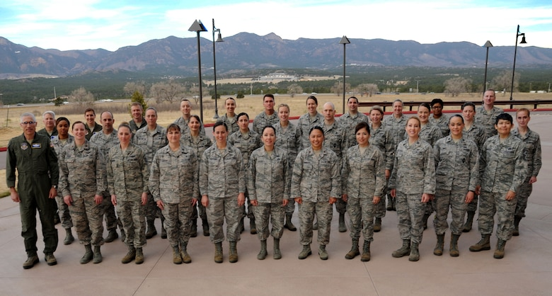 Executive officers from across the 22nd Air Force pose for a photo during the 22nd AF Executive Officer Development Workshop in Colorado Springs, Colorado, April 11, 2018. The workshop, hosted by the 302nd Airlift Wing and the 340th Flying Training Group, was the first of its kind offered across the 22nd Air Force. (U.S. Air Force photo by Staff Sgt. Frank Casciotta)