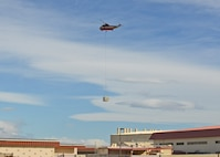 Siller Helicopters, Inc. flew in an S-61V Sikorsky to replace 22 evaporative coolers on the 412th Maintenance Group's headquarters building. Seven of the coolers also had heaters as part of the unit.