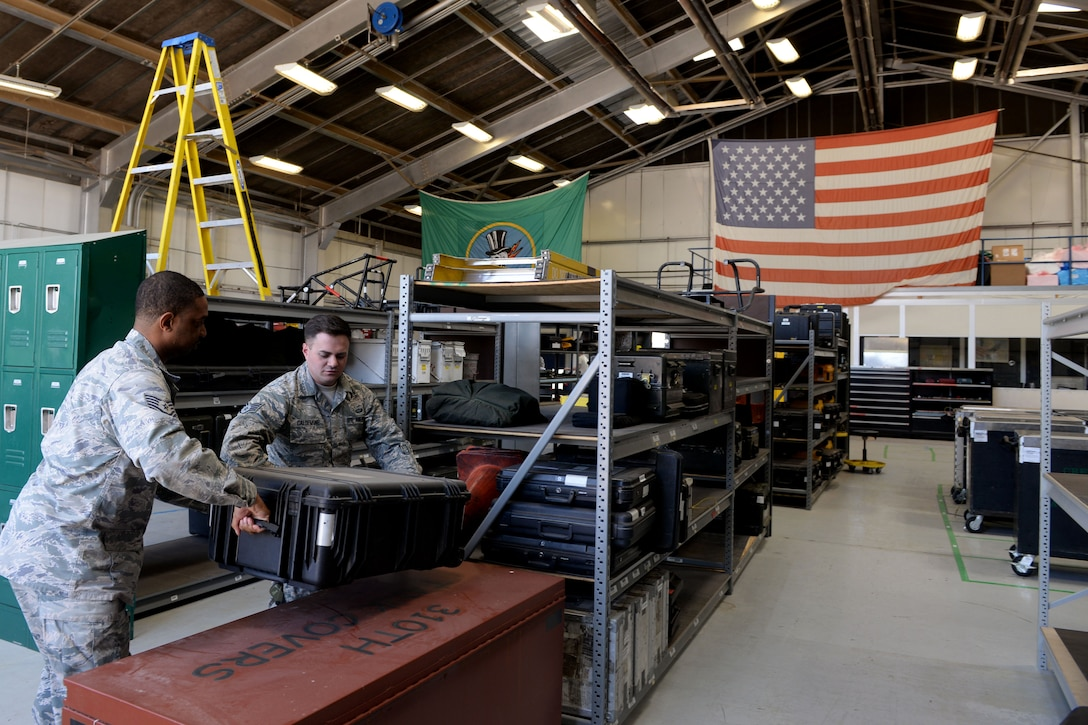 Tech. Sgt. Andrew Clayton, 310th Aircraft Maintenance Unit supply section lead, and Staff Sgt. Tanner Caldemone, 310th AMU aircraft armament technician, prepare to load a cargo box at Luke Air Force Base, Ariz., April 18, 2018.  The 310th supply section was recently relocated to a temporary location for building renovations. (U.S. Air Force photo by Senior Airman Pedro Mota)