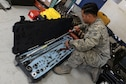 Senior Airman Joseph Nunez, 310th Aircraft Maintenance Unit aerospace propulsion journeyman, inspects a fuel tank installation kit at Luke Air Force Base, Ariz., April 18, 2018. The installation kit and other cargo will  be used at a training event in San Diego, Calif. (U.S. Air Force photo by Senior Airman Pedro Mota)