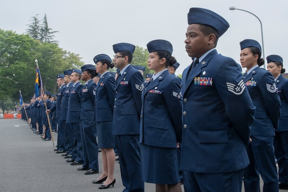 Airmen from the 374th Medical Group stand in formation during an open-ranks inspection at Yokota Air Base, Japan, April 19, 2018.