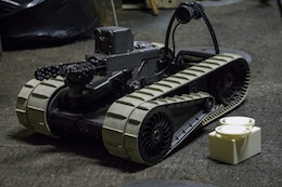 An iRobot 310 Small Unmanned Ground Vehicle belonging to Combat Logistic Battalion 31, 31st Marine Expeditionary Unit, sits staged with 3-D printed lens covers aboard the USS Wasp while underway in the Pacific Ocean, April 17, 2018. Marines with CLB-31 are now capable of 'additive manufacturing,' also known as 3-D printing, which is the technique of replicating digital 3-D models as tangible objects.  The 31st Marine Expeditionary Unit partners with the Navy's Amphibious Squadron 11 to form the Wasp Amphibious Ready Group, a cohesive blue-green team capable of accomplishing a variety of missions across the Indo-Pacific.