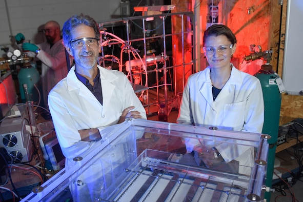 Professors Selma Mededovic Thagard and Thomas Holsen, the Clarkson University team responsible developing the enhanced contact electrical discharge plasma reactor - a new method for degrading poly- and perfluoroalkyl substances including PFOS and PFOA - pose for a photo.