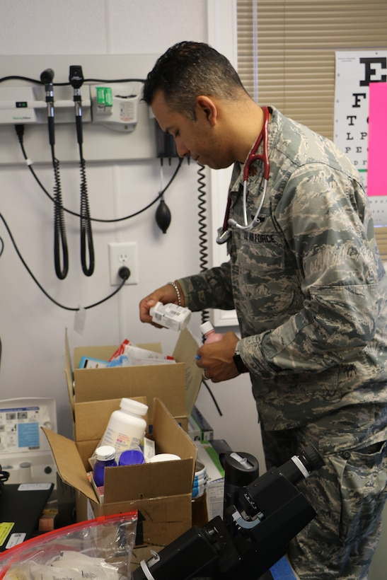 Major Vashun Rodriguez a flight surgeon assigned to the 927th Aeromedical Staging Squadron, MacDill Air Force Base FL, selects the proper antibiotic for a patient at the Kivalina Clinic, Kivalina, Alaska, April 18, 2018 in support of Arctic Care. Innovative Readiness Training exercises such as Arctic Care 2018 continue to build on the long-standing tradition of U.S. Armed Forces addressing the underserved community health and civic needs of the Northwest Arctic Borough. (U.S. Air Force photo by Maj. Joseph Simms)