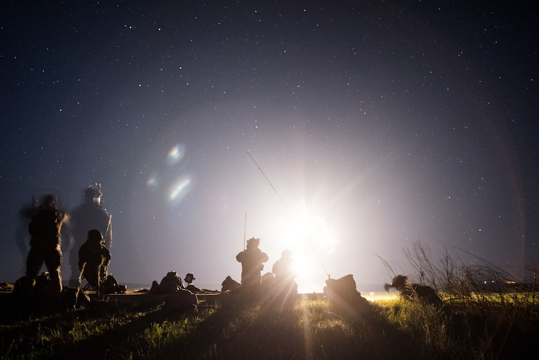 Tactical Air Control Party specialists locate targets during a night operation while participating in a field training exercise, or FTX, at Fort Chaffee Maneuver Training Center in Arkansas, April 14, 2018. The FTX, April 13-17, 2018, took place at the end of a two-month Initial Combat Skills Training Course, which is hosted by the 138th Combat Training Flight at Will Rogers Air National Guard Base in Oklahoma City, and is the only one of its kind in the U.S. Air Force. (U.S. Air National Guard Photo by Staff Sgt. Tyler K. Woodward)