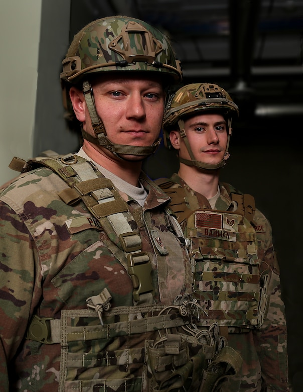 Staff Sgts. Jonathan L. Pack and Alan G. Bauman, assigned to the 157th Civil Engineer Squadron, N.H. Air National Guard, pose for a portrait on April 17, 2018 at Pease Air National Guard Base, N.H. Pack and Bauman became the first members of the 157th Air Refueling Wing to compete in the Best Warrior Competition in 2018. (N.H. Air National Guard photo by Staff Sgt. Kayla White)