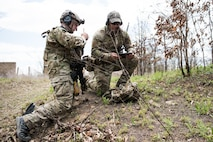 A Tactical Air Control Party specialist speaks with an instructor while participating in a field training exercise, or FTX, at Fort Chaffee Maneuver Training Center in Arkansas, April 15, 2018. The FTX, April 13-17, 2018, took place at the end of a two-month Initial Combat Skills Training Course, which is hosted by the 138th Combat Training Flight at Will Rogers Air National Guard Base in Oklahoma City, and is the only one of its kind in the U.S. Air Force. (U.S. Air National Guard Photo by Staff Sgt. Kasey M. Phipps)