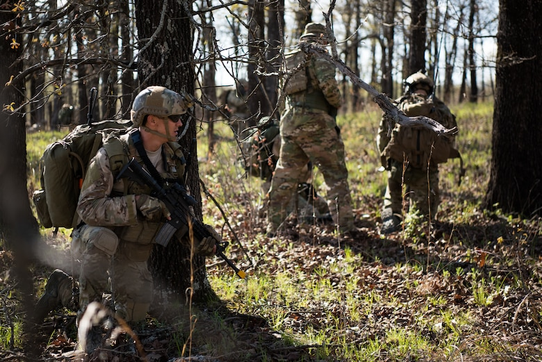 A Tactical Air Control Party specialist provides oversight for his team while participating in a field training exercise, or FTX, at Fort Chaffee Maneuver Training Center in Arkansas, April 15, 2018. The FTX, April 13-17, 2018, took place at the end of a two-month Initial Combat Skills Training Course, which is hosted by the 138th Combat Training Flight at Will Rogers Air National Guard Base in Oklahoma City, and is the only one of its kind in the U.S. Air Force. (U.S. Air National Guard Photo by Staff Sgt. Kasey M. Phipps)