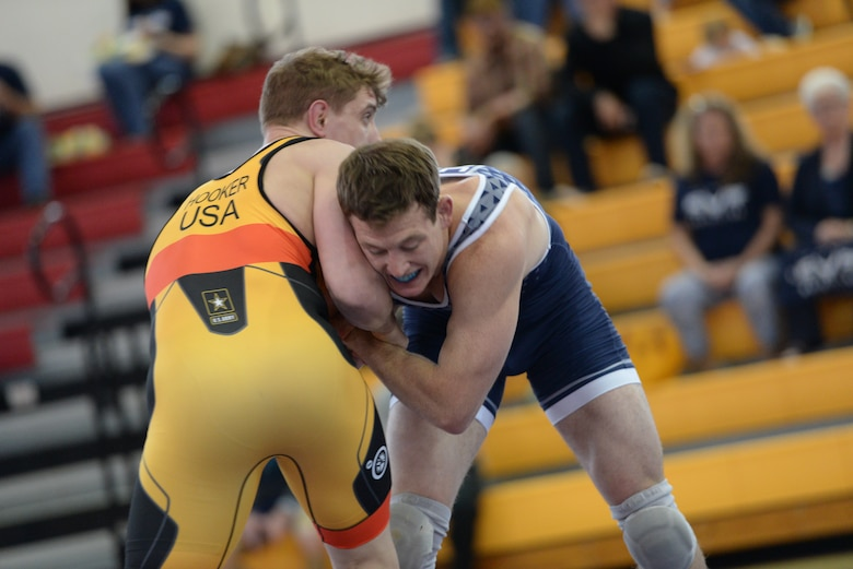 Capt. Brandon Mueller in blue grapples with the Army's Michael Hooker at the 2017 Armed Forces Championships.