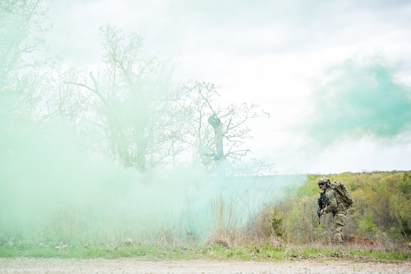 A Tactical Air Control Party specialist approaches an enemy position while participating in a field training exercise, or FTX, at Fort Chaffee Maneuver Training Center in Arkansas, April 14, 2018. The FTX, April 13-17, 2018, took place at the end of a two-month Initial Combat Skills Training Course, which is hosted by the 138th Combat Training Flight at Will Rogers Air National Guard Base in Oklahoma City, and is the only one of its kind in the U.S. Air Force. (U.S. Air National Guard Photo by Staff Sgt. Kasey M. Phipps)