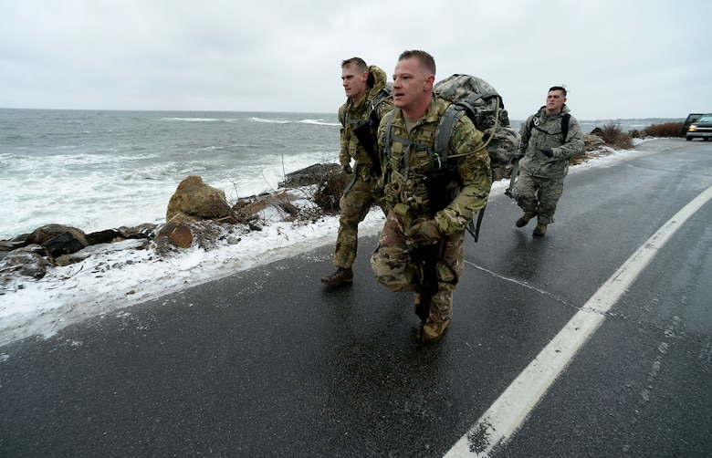 Staff Sgts. Jonathan L. Pack and Alan G. Bauman, assigned to the 157th Civil Engineer Squadron, N.H. Air National Guard, run during the 12-mile ruck march on April 15, 2018 at Newcastle, N.H. Pack and Bauman became the first members of the 157th Air Refueling Wing to compete in the Best Warrior Competition in 2018. (N.H. Army National Guard photo by Staff Sgt. Rick Frost)