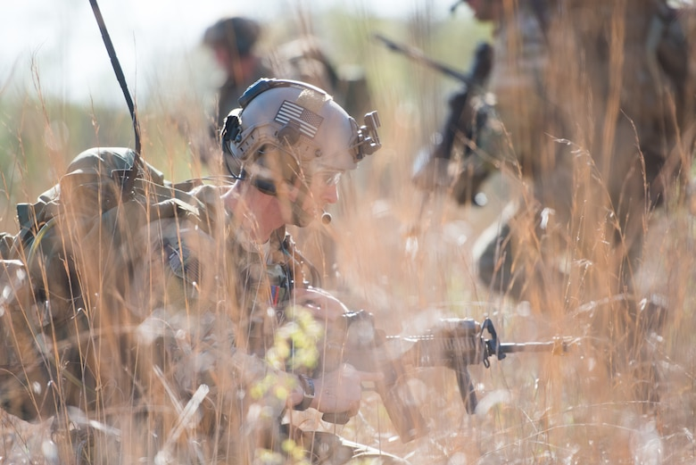 A Tactical Air Control Party specialist listens to his team on his radio while participating in a field training exercise, or FTX, at Fort Chaffee Maneuver Training Center in Arkansas, April 14, 2018. The FTX, April 13-17, 2018, took place at the end of a two-month Initial Combat Skills Training Course, which is hosted by the 138th Combat Training Flight at Will Rogers Air National Guard Base in Oklahoma City, and is the only one of its kind in the U.S. Air Force. (U.S. Air National Guard Photo by Staff Sgt. Tyler K. Woodward)