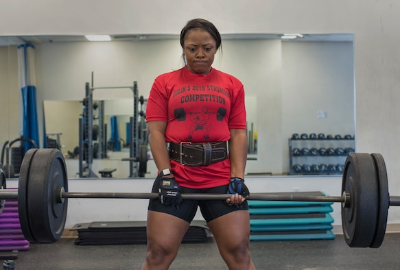 U.S. Air Force Staff Sgt. Ashley Bethel, 33rd Maintenance Squadron Command Support Staff noncomissioned officer in charge, performs a deadlift March 29, 2018, at Eglin Air Force Base, Fla. Bethel competed in the Eglin's Strongest Competition and took first place in the female category. (U.S. Air Force photo by Airman 1st Class Daniella Peña-Pavao)