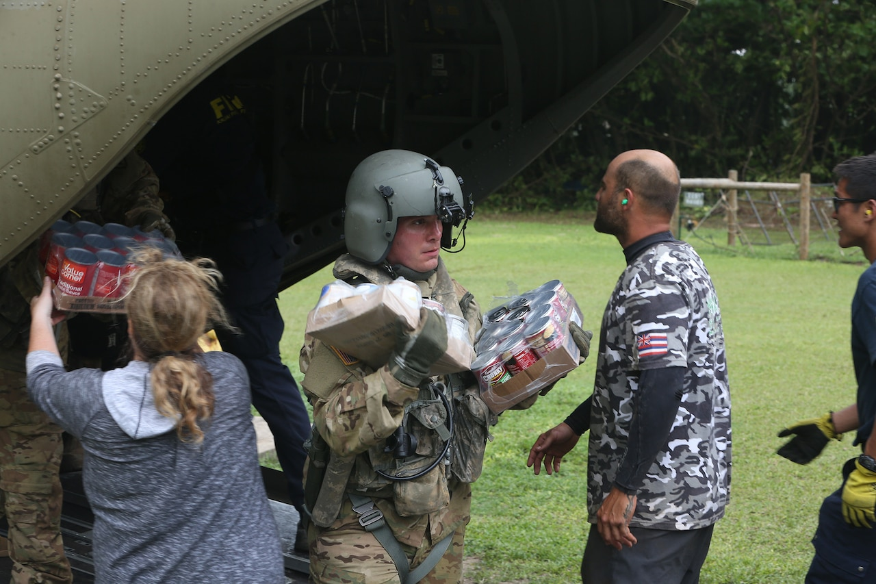 A 25th Infantry Division soldier aids in efforts to transport emergency vehicles, food, water, bedding, hygiene products and other supplies to residents and visitors of the Hawaii island of Kauai.