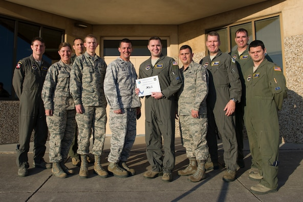 "Capt. Stephen MacDonald, 85th Flying Training Squadron assistant director of operations, was chosen by wing leadership to be the ""XLer"" of the week, for the week of Apr. 9, 2018, at Laughlin Air Force Base, Texas. The ""XLer"" award, presented by Col. Charlie Velino, 47th Flying Training Wing commander, is given to those who consistently make outstanding contributions to their unit and the Laughlin mission."
