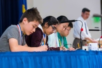 Students from regional elementary and middle schools participate in the MATHCOUNTS-style speed round as Dr. Paul Shang, acting technical director for Naval Surface Warfare Center, Carderock Division, feeds them the math problems at the Carderock Math Contest in West Bethesda, Md., on April 13, 2018. (U.S. Navy photo by Jake Cirksena/Released)