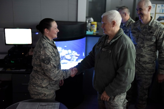 U.S. Air Force Lieutenant General L. Scott Rice, director of the Air National Guard, coins U.S. Air Force Staff Sgt. Tara Zuber, a command post controller assigned to the 180th Fighter Wing, Ohio Air National Guard, during his base visit April 11, 2018. Zuber provided first-aid for a pedestrian who'd been struck by a car in Toledo, Ohio, potentially saving the pedestrian's life. (U.S. Air National Guard photo by Staff Sgt. Shane Hughes)
