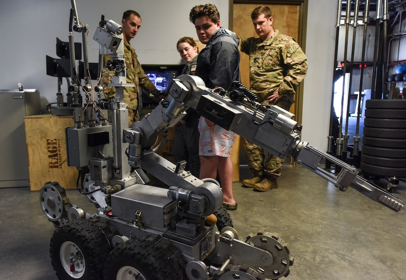 Explosive Ordnance Disposal Airmen with the 628th Civil Engineer Squadron show Airman for a Day participants an EOD robot April 12, 2018, at Joint Base Charleston, S.C.