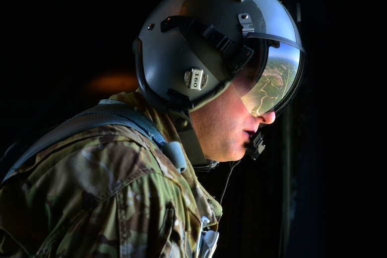Staff Sgt. Michael Demik, 39th Airlift Squadron evaluator loadmaster, surveys an area during Green Flag Little Rock April 10, 2018, near Alexandria, La. Green Flag allows the Air Force to work with sister services and partners in the Mobility Air Forces to prepare mobility Airmen for real-world threats. (U.S. Air Force photo by Airman 1st Class Codie Collins)