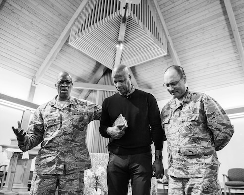 Maj. Kemuel Bellows, chaplain, former Major League Baseball player Darryl Strawberry, and Col. Kenneth Reyes, 60th Air Mobility Wing chaplain, pray after Strawberry's presentation at Travis Air Force Base, Calif., April 11, 2018. The former Rookie of the Year and four-time World Series champion spent 17 years in the Majors. Strawberry's addiction to drugs and other vices are well chronicled and now uses those experiences to motivate others. As a pastor, he uses his testimony to instill healing through spirituality. (U.S. Air Force photo by Louis Briscese)