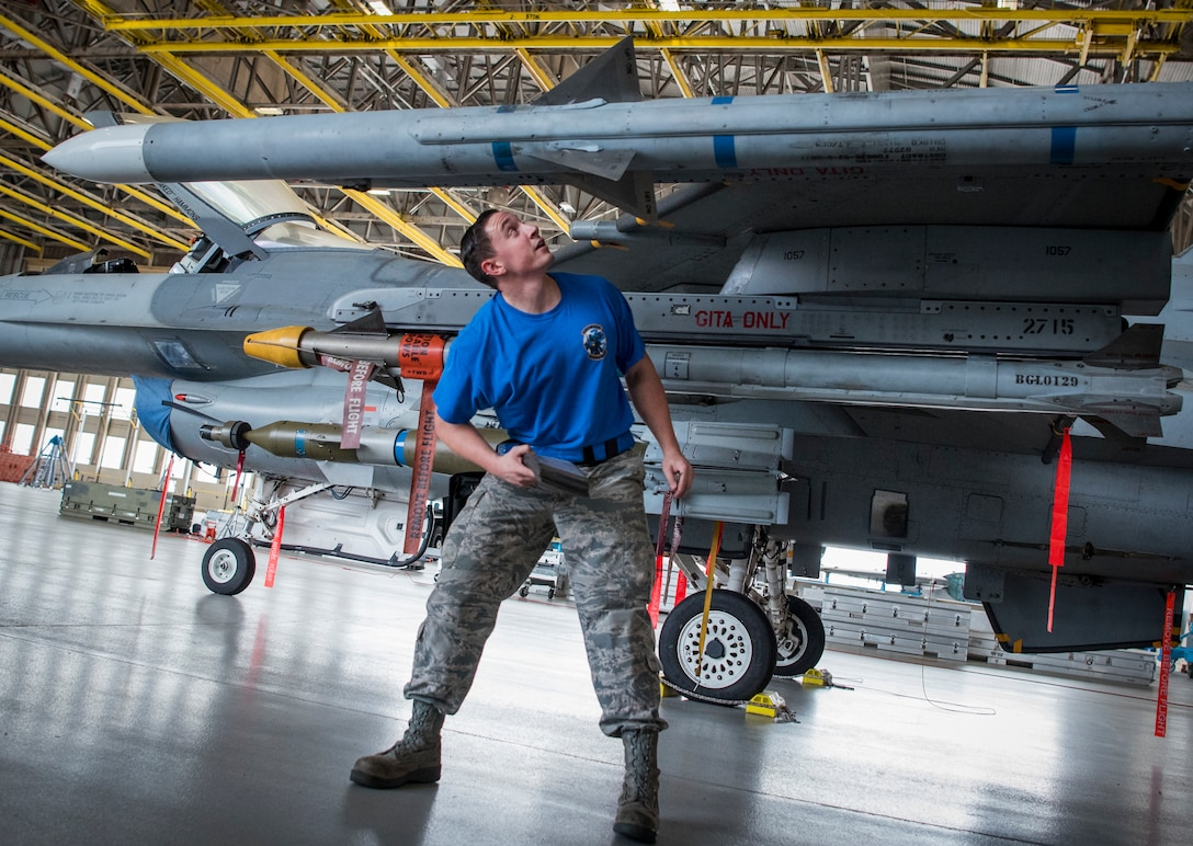 Staff Sgt. Trey Riley, member of the 96th Aircraft Maintenance Squadron blue team, performs load checks on his F-16 Fighting Falcon April 13, 2018, at Eglin Air Force Base, Fla. The blue team battled the AMU red team for weapons loadcrew supremacy during the quarterly competition. The red team claimed victory this quarter. (U.S. Air Force photo by Samuel King Jr.)