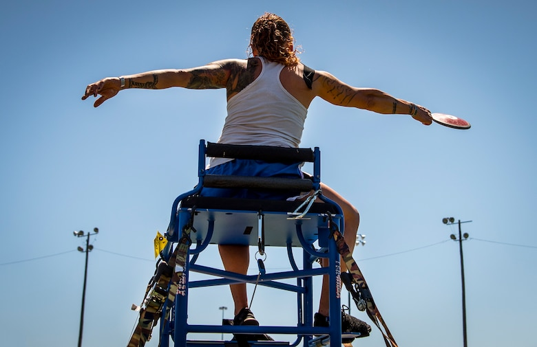 Kristina Coble, Warrior Games athlete, releases her disc during a track and field session at the Air Force team's training camp at Eglin Air Force Base, Fla., April 17, 2018. The base-hosted, week-long Warrior Games training camp is the last team practice session before the yearly competition in June. (U.S. Air Force photo by Samuel King Jr.)