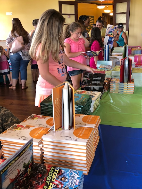 Children pick out books during the Books on Bases event at the Ka Makani Community Center, Joint Base Pearl Harbor-Hickam, Hawaii, April 13, 2017. The event was held to celebrate the Month of the Military Child, and to recognize the unique lifestyle of military families. (U.S. Air Force photo by Tech. Sgt. Heather Redman)