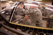 Brig. Gen. Brook Leonard, 56th Fighter Wing commander, learns about an innovative process for F-35 Lightning II canopy component replacement from Staff Sgt. Tyler Volk, 56th Component Maintenance Squadron egress technician April 13, 2018, at Luke Air Force Base, Ariz. The 56th CMS spent two months refining the process to replace the charges that separate the canopy from the jet during ejection, condensing it from 10 days to three. (U.S. Air Force photo by Senior Airman Ridge Shan)
