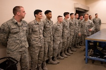 Brig. Gen. Brook Leonard, 56th Fighter Wing commander, greets egress flight Airmen from the 56th Component Maintenance Squadron during a visit in recognition of their accomplishments April 13, 2018, at Luke Air Force Base, Ariz. The egress section developed an innovative process for replacing F-35 Lightning II flexible linear shaped charges, a crucial component of the ejection system, which will reduce maintenance time from 178 hours to 51 by May. (U.S. Air Force photo by Senior Airman Ridge Shan)