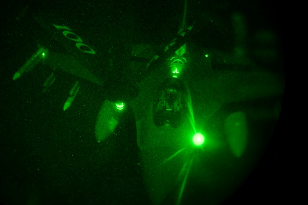 An aircraft is seen refueling with another through night vision device.