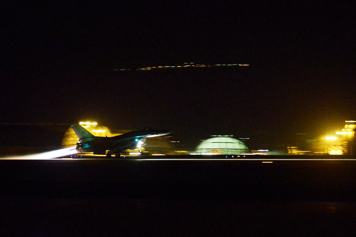 An aircraft takes off at night.