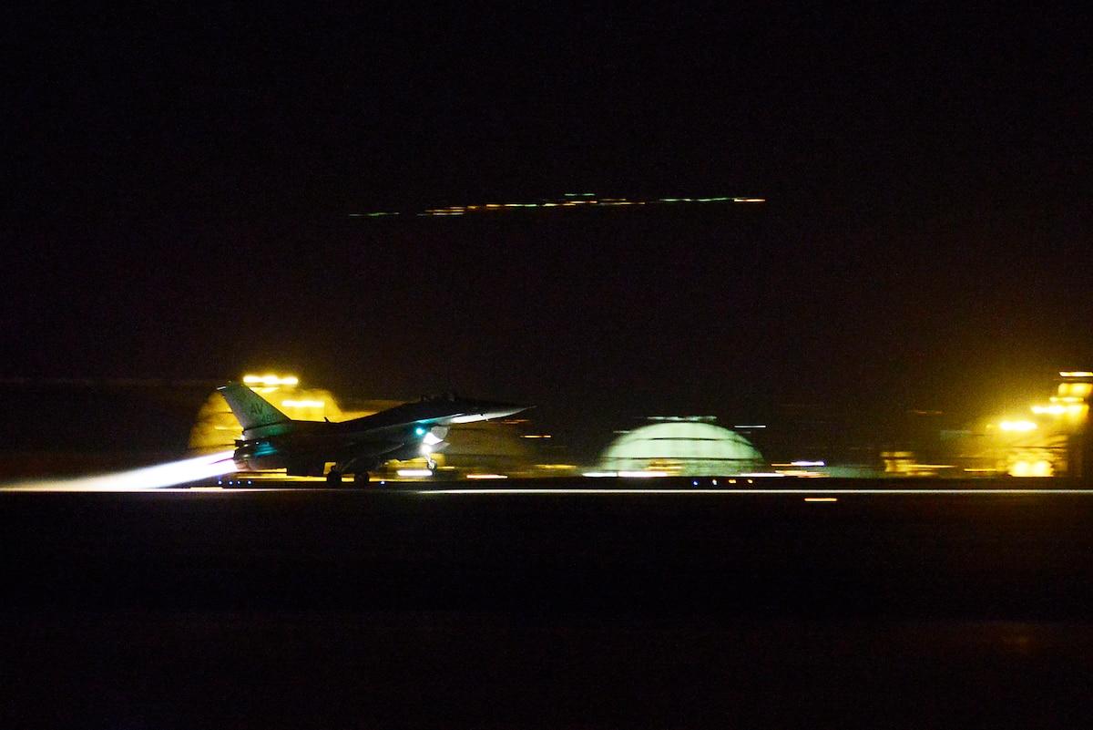 An aircraft takes off at night.