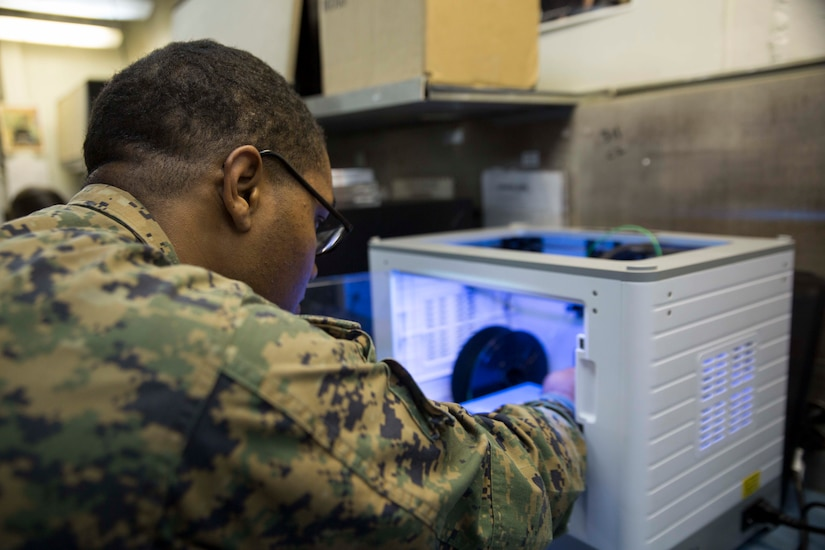 Marine with Combat Logistics Battalion 31, 31st Marine Expeditionary Unit, prepares to print 3D model aboard USS Wasp while underway in Pacific Ocean, April 7, 2018 (U.S. Marine Corps/Bernadette Wildes)
