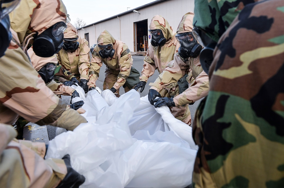 U.S. Airmen assigned to the 86th Civil Engineer Group simulate decontamination procedures during a chemical, biological, radiological, and nuclear training exercise on Ramstein Air Base, Germany, April 12, 2018. The 786th Civil Engineer Squadron's emergency management flight helps train Airmen in matters concerning CBRN defense. (U.S. Air Force photo by Senior Airman Joshua Magbanua)