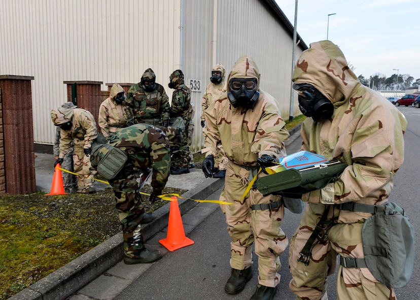 U.S. Airmen assigned to the 86th Civil Engineer Group set up a simulated cordon during a training exercise on chemical, biological, radiological, and nuclear defense on Ramstein Air Base, Germany, April 12, 2018. During CBRN training, Airmen learn how to respond against various kinds of threats. (U.S. Air Force photo by Senior Airman Joshua Magbanua)
