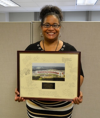 Brenda Hall, a DLA Troop Support procurement analyst, poses with her going-away gift from her time in the DLA Enterprise Rotation Program, Feb. 28, 2018 in Philadelphia.