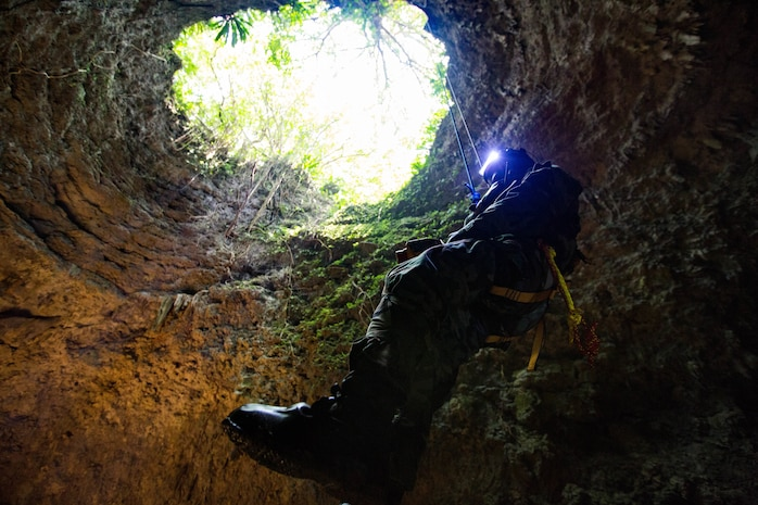 A U.S. Marine ascends out of a cave in mission oriented protective posture gear on Marine Corps Air Station Futenma, Okinawa, Japan on April 19, 2018, Chemical, biological, radiological, and nuclear Marines conducted simulated site exploitation to detect chemical or radiological threats in areas that are difficult to access. The Marines are CBRN specialists with Headquarters Battalion, 3rd Marine Division.