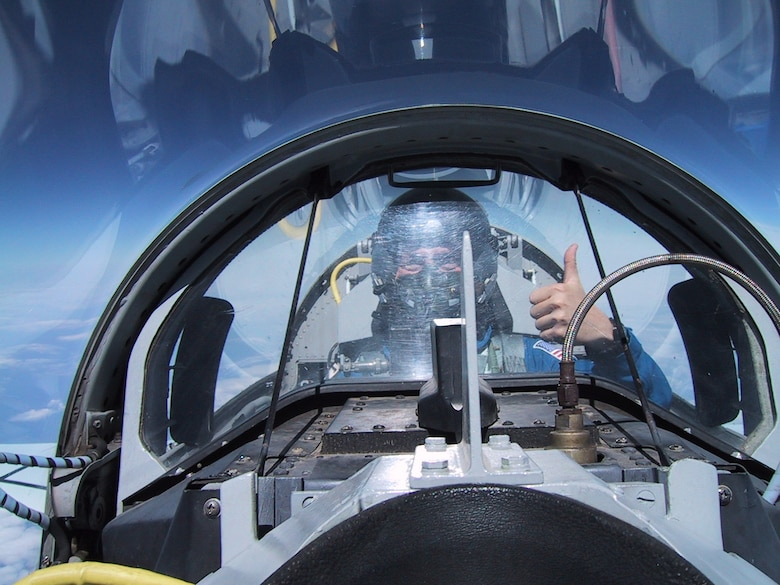 Then-Maj. (Dr.) Josef Schmid, a reserve mobilization assistant to the Air Force Surgeon General, and civilian NASA flight surgeon, flies the T-38 in May 2002. Because of his reserve and civilian roles, Schmid is familiar with the rigors of flight and is able to administer care to both Airmen and astronauts. (Courtesy photo)