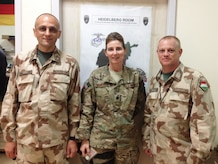 Then-Lt. Col. Lisa Banyasz-de Silva, a reserve division chief with Air Force Reserve Command (AFRC), poses for a photo with two members of the Hungarian military while assigned to the Combined Joint Operations Center during a 2014 NATO deployment at Kabul International Airport, Afghanistan. Banyasz-de Silva, who is also a civilian nurse, provides programming and oversight of medical professionals and financial resources for 82 reserve medical units. She also develops policy and training to enable medical units to produce combat ready Airmen. (Courtesy photo)