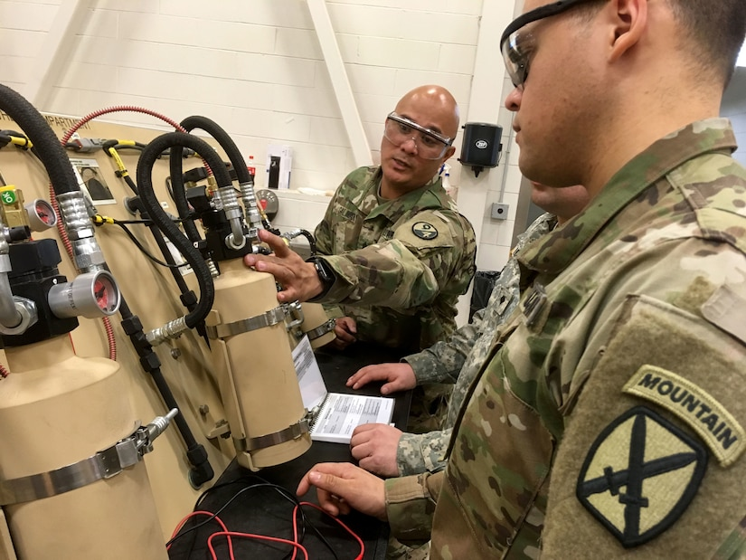 Sgt. 1st Class Gilbert Galman, a 94th Training Division instructor at Regional Training Site - Maintenance (RTS-M) Devens, prepares his students for a classroom test reviewing the fundamentals of maintaining an automatic fire extinguinshing system on a wheeled vehicle during the 91B Wheeled Vehicle Mechanic Course, 28 March 2018. Galman currently holds the mantle of Instructor of the Year at RTS-M Devens after the leadership chose him in October 2017 following a rigorous board selection process. He went on to represent Devens the next month at the 2017 Instructor of the Year competition sponsored by the 80th Training Command (TASS). According to his supervisors, Galman pushes his students to excel and his passion and dedication enhances the entire team at RTS-M Devens. (U.S. Army Reserve photo by Master Sgt. Benari Poulten, 80th Training Command)
