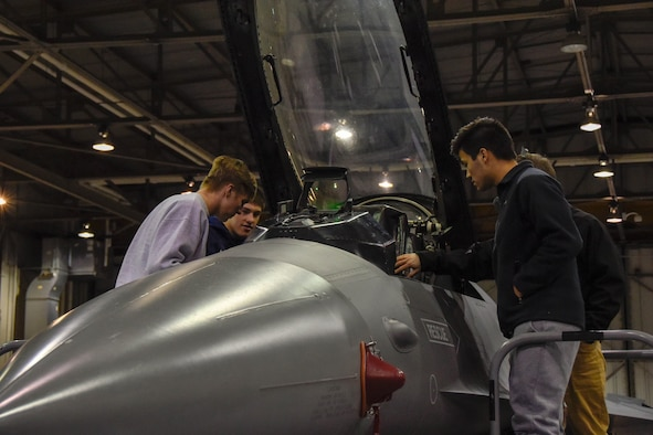 High School students take a quick look at a F-16 Fighting Falcon cockpit during Night Flying Career Day at Joe Foss Field, S.D. on April 17, 2018.