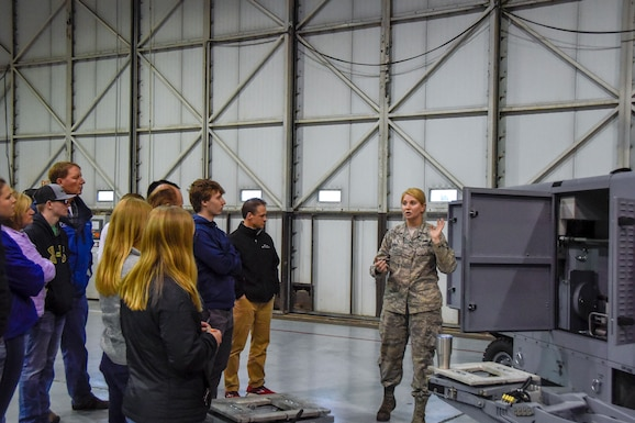 Staff Sgt. Jessica Janke, 114th Maintenance Squadron aerospace ground equipment technician, talks about her career field and experiences in the military during Night Flying Career Day at Joe Foss Field, S.D. on April 17, 2018.