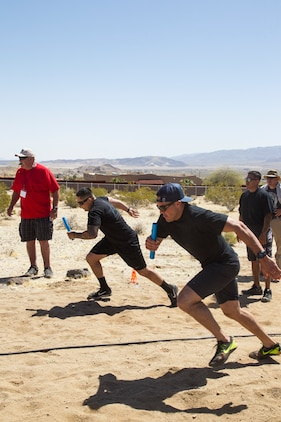 Deputies from the San Bernardino County Sheriff's Department compete in the 40-meter dash relay race at the inaugural Tug-of-War Competition hosted by the Desert Refuge for Peace Officers and Military Personnel in Joshua Tree, Calif., April 14, 2018. The event also included barbecue lunch, live music, giveaways and inter-faith prayer services. (U.S. Marine Corps photo by Cpl. Dave Flores)