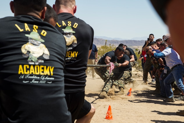 Marines from the Marine Corps Air Ground Combat Center and deputies from the Los Angeles County Sheriff's Department battle each other in a tug-of-war match at the inaugural Tug-of-War Competition hosted by the Desert Refuge for Peace Officers and Military Personnel in Joshua Tree, Calif., April 14, 2018. The event also included a barbecue lunch, live music, giveaways and inter-faith prayer services. (U.S. Marine Corps photo by Cpl. Dave Flores)