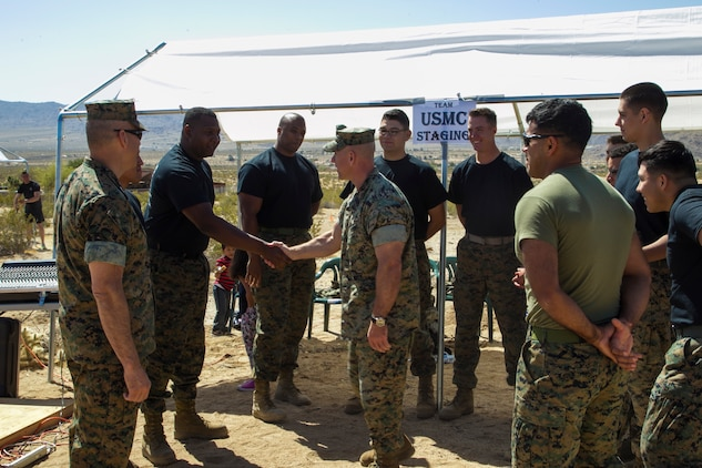 Maj. Gen. William F. Mullen III, Marine Corps Air Ground Combat Center Commanding General, and Sgt. Maj. Michael Hendges, Combat Center Sergeant Major, speak to the Marines competing in the inaugural Tug-of-War Competition hosted by the Desert Refuge for Peace Officers and Military Personnel in Joshua Tree, Calif., April 14, 2018. The event also included barbecue lunch, live music, giveaways and inter-faith prayer services. (U.S. Marine Corps photo by Cpl. Dave Flores)