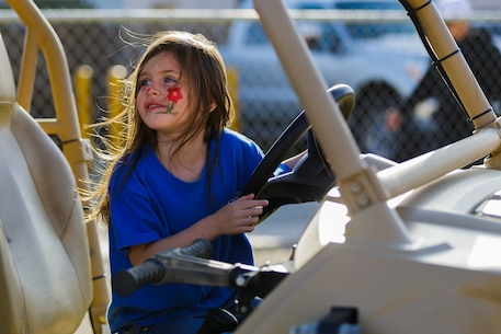 Lillian Benavidez, 6, daughter of Staff Sgt. Guadalupe Benavidez, career planner, 2nd Battalion, 7th Marine Regiment, explores a Polaris MRZR D4 that was on display during the 4th Annual Earth Day Extravaganza aboard the Marine Corps Air Ground Combat Center, Twentynine Palms, Calif., April 13, 2018. The purpose of the extravaganza is to bring families together and educate them on how to be better stewards of the Earth's resources. (U.S. Marine Corps photo by Lance Cpl. Rachel K. Porter)