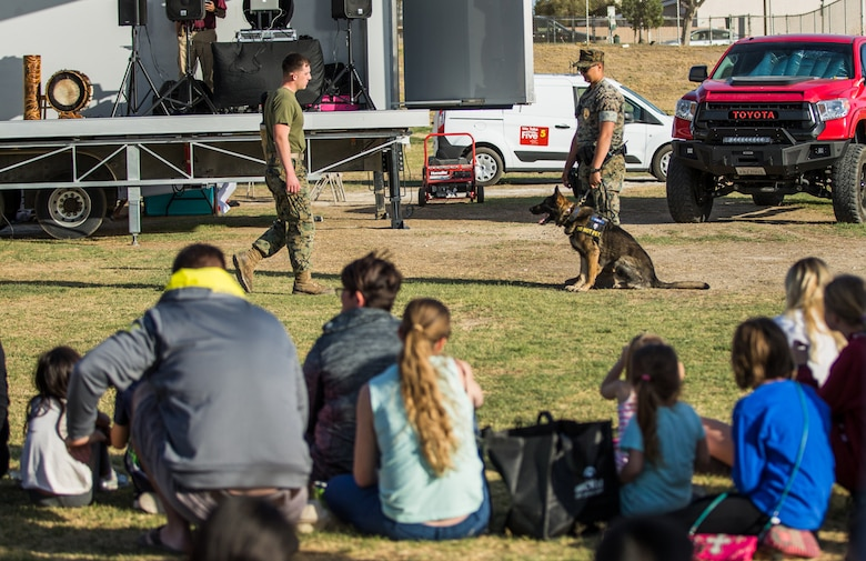 Marines with the Military Working Dog section of the Provost Marshal's Office, participate in a K-9 demonstration during the 4th Annual Earth Day Extravaganza aboard the Marine Corps Air Ground Combat Center, Twentynine Palms, Calif., April 13, 2018. The purpose of the extravaganza is to bring families together and educate them on how to be better stewards of the Earth's resources. (U.S. Marine Corps photo by Lance Cpl. Rachel K. Porter)