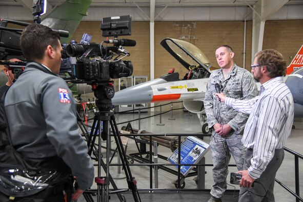 Lt. Col. Jeff Thomas, 75th Operations Support Squadron commander and Warriors Over the Wasatch Air and Space Show coordinator, is interviewed April 19, 2018, by media reporters to officially announce that the air and space show ill be held June 23-24 at Hill Air Force Base, Utah. (U.S. Air Force Photo by Cynthia Griggs)