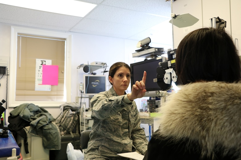 Captain Roxanne Buffano, an optometrist assigned to the 927th Aerospace Medicine Squadron, MacDill AFB FL, conducts an eye exam April 17 in support of Arctic Care 2018, at the Kivalina Clinic, Kivalina, Alaska. Arctic Care 2018 is an Innovative Readiness Training exercise comprised of a joint and multi-national force providing medical, dental, optometry and veterinary care for underserved villages in the Maniillaq Service Area April 16-24. (U.S. Air Force photo by Maj. Joe Simms)