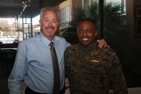 Brig. Gen. Dimitri Henry, U.S. Marine Corps Director of Intelligence, (right) attends Larry Stratton's, former Deputy Director of Marine Corps Community Services, retirement ceremony at the Frontline Restaurant aboard the Marine Corps Air Ground Combat Center, Twentynine Palms, Calif., March 29, 2018. Stratton, a retired Marine Corps master sergeant, was Henry's drill instructor at Marine Corps Recruit Depot San Diego, Calif., in 1981. (U.S. Marine Corps photo by Lance Cpl. Preston L. Morris)